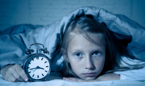 child having trouble staying asleep with clock